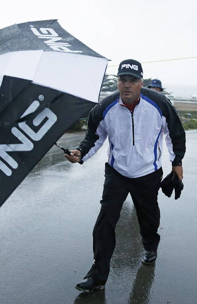 Daniel Chopra of Sweden leaves the Monterey Peninsula Country Club Shore Course after the first round of the AT&T Pebble Beach Pro-Am golf tournament was suspended because of steady rain Thursday, Feb. 6, 2014, in Pebble Beach, Calif