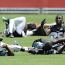 Philadelphia Eagles' LeSean McCoy, right, talks to Darren Sproles, bottom, while they stretch during NFL football training camp on Sunday, July 27, 2014, in Philadelphia The Associated Press