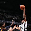 NEW YORK, NY - MARCH 31: Thaddeus Young #30 of the Brooklyn Nets shoots against the Indiana Pacers on March 31, 2015 at the Barclays Center in the Brooklyn borough of New York City. (Photo by Nathaniel S. Butler/NBAE via Getty Images)