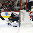 Carolina Hurricanes' Brett Bellemore (73) and goalie Anton Khudobin (31), of Kazakhstan, defend the goal against Florida Panthers' Marcel Goc (57), of Germany, during the first period of an NHL hockey game in Raleigh, N.C., Friday, Feb. 7, 2014 The Associ