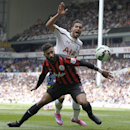 Tottenham Hotspur's Nacer Chadli, back, competes for the ball with Queens Park Rangers' Armand Traore during their English Premier League soccer match at White Hart Lane, London, Sunday, Aug. 24, 2014