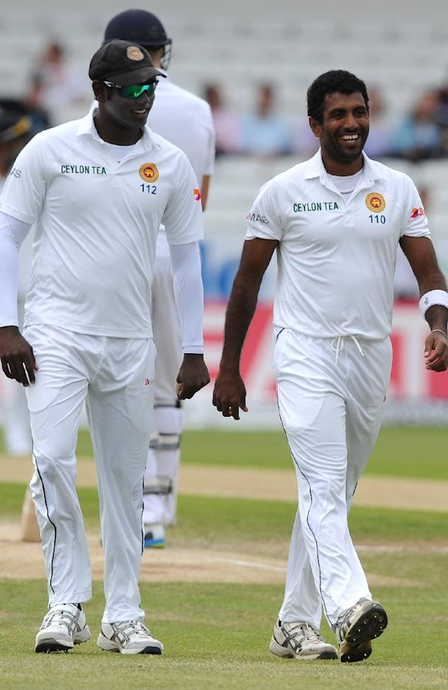 Sri Lanka's Angelo Mathews, left, encourages teammate Dhammika Prasad during day five of the Second Test Match between England and Sri Lanka at Headingley cricket ground, Leeds, England, on Tuesday, June 24, 2014