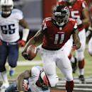 Atlanta Falcons wide receiver Julio Jones (11) runs against Tennessee Titans strong safety Bernard Pollard (31) during the first half of an NFL preseason football game, Saturday, Aug. 23, 2014, in Atlanta. Jones scored a touchdown on the play The Associat