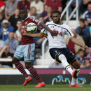 West Ham United's Enner Valencia, left, competes for the ball withTottenham Hotspur's Etienne Capoue during their English Premier League soccer match at Upton Park, London, Saturday, Aug. 16, 2014