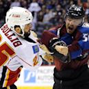 Colorado Avalanche defenseman Daniel Maggio (56) fights with Calgary Flames left wing Brandon Bollig (25) during the first period of a preseason NHL hockey game Sunday, Sept. 28, 2014, in Denver. The Associated Press