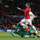 Manchester United's Robin van Persie, No 20, attempts a shot on goal as Donetsk's goalkeeper Andriy Pyatov dives to block during their Champions League group A soccer match between Manchester United and Shakhtar Donetsk at Old Trafford Stadium, Manchester
