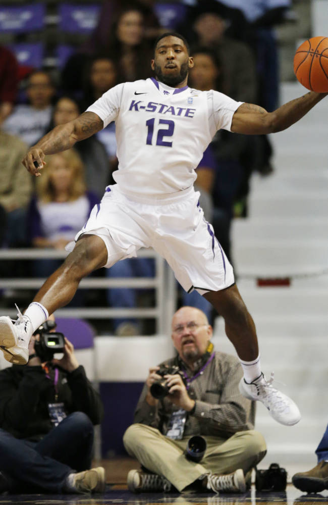 Kansas State guard Omari Lawrence (12) saves the ball from going out of bounds during the first half of an NCAA college basketball game against Troy in Manhattan, Kan., Sunday, Dec. 15, 2013. Kansas State defeated Troy 72-43