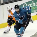 San Jose Sharks defenseman Brent Burns, right, goes for the puck as Philadelphia Flyers center Zac Rinaldo (36) gives chase during the first period of an NHL hockey game Tuesday, Dec. 2, 2014, in San Jose, Calif The Associated Press