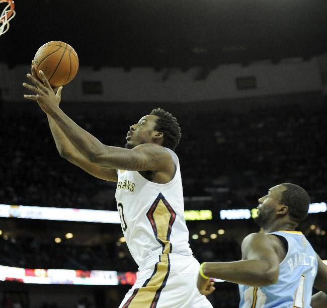 New Orleans Pelicans forward Al-Farouq Aminu (0) shoots in front of Denver Nuggets guard Jordan Hamilton (1) in the second half of an NBA basketball game in New Orleans, Friday, Dec. 27, 2013. New Orleans won 105-89