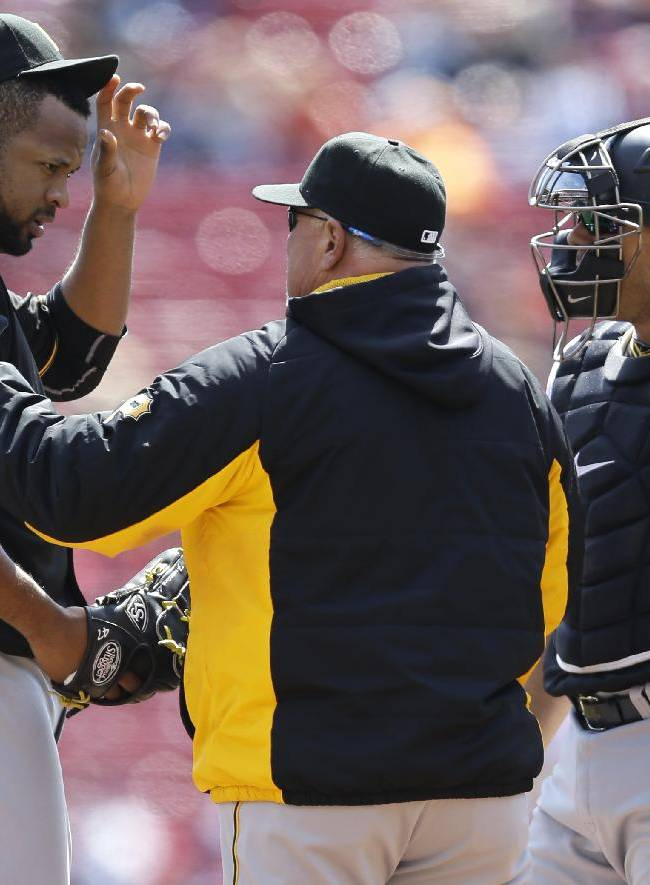 Pittsburgh Pirates starting pitcher Francisco Liriano, left, talks with pitching coach Ray Searage in the first inning of a baseball game against the Cincinnati Reds, Wednesday, April 16, 2014, in Cincinnati. Catcher Tony Sanchez listens at right