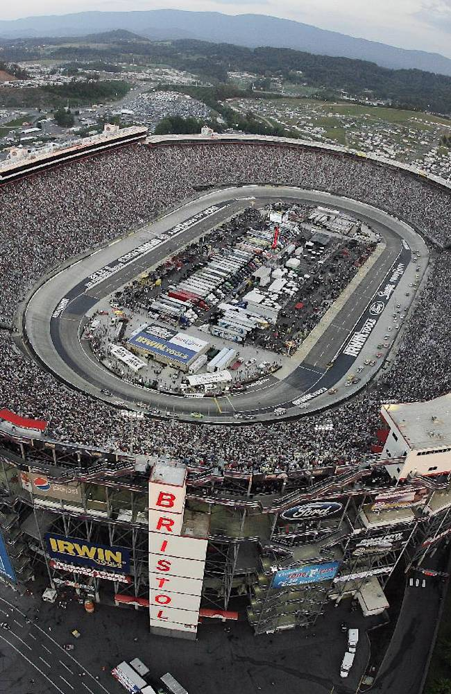 In this Aug. 25, 2012, file photo, the NASCAR Sprint Cup Series auto race is run at Bristol Motor Speedway in Bristol, Tenn. A person with knowledge of the plans tells The Associated Press on Wednesday, Oct. 9, 2013, that Tennessee and Virginia Tech will play an NCAA college football game at the speedway in September 2016. The person spoke on condition of anonymity because an official announcement is still in the works. The speedway holds 150,000. The attendance record for college football is 115,109, set last month at Michigan Stadium for the Michigan-Notre Dame game
