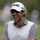 Olympic swimmer Michael Phelps participates in the TOUR Wives Golf Classic, as part of The Players Championship golf tournament at TPC Sawgrass in Ponte Vedra Beach, Fla., Tuesday, May 7, 2013. (AP Photo/Gerald Herbert)