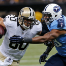 New Orleans Saints tight end Jimmy Graham (80) carries on a reception against Tennessee Titans middle linebacker Wesley Woodyard in the first half of a NFL football preseason game in New Orleans, Friday, Aug. 15, 2014 The Associated Press