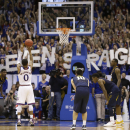 Kansas guard Frank Mason III (0) shoots a free throw during overtime of an NCAA college basketball game against West Virginia at Allen Fieldhouse in Lawrence, Kan., Tuesday, March 3, 2015. Kansas defeated West Virginia 76-69. (AP Photo/Orlin Wagner)