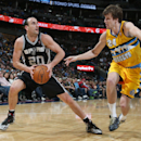 San Antonio Spurs guard Manu Ginobili, left, of Argentina, looks to shoot ball as Denver Nuggets forward Jan Vesely, of the Czech Republic, covers in the fourth quarter of the Spurs' 133-102 victory in an NBA basketball game in Denver, Friday, March 28, 2