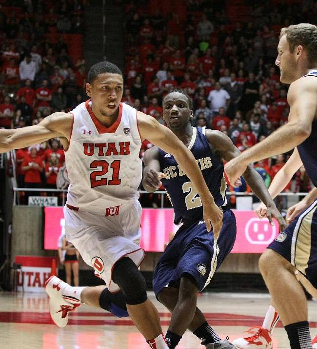 Utah Utes forward Jordan Loveridge (21) drives through the key during second half play. Utah defeated UC Davis 94-60, Friday, November 15, 2013 in Salt Lake City, Utah
