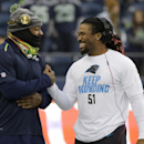 Seattle Seahawks running back Marshawn Lynch, left, shakes hands with Carolina Panthers running back DeAngelo Williams before an NFL divisional playoff football game in Seattle, Saturday, Jan. 10, 2015 The Associated Press