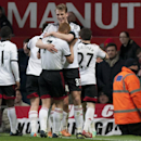 Fulham players celebrate after they drew 2-2 with a late goal from Darren Bent during their English Premier League soccer match against Manchester United at Old Trafford Stadium, Manchester, England, Sunday Feb. 9, 2014
