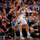 DALLAS, TX - MARCH 30: Dirk Nowitzki #41 of the Dallas Mavericks is defended by Taj Gibson #22 of the Chicago Bulls on March 30, 2013 at the American Airlines Center in Dallas, Texas. (Photo by Glenn James/NBAE via Getty Images)