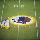 In this Aug. 28, 2009 file photo, the Washington Redskins logo is shown on the field before the start of a preseason NFL football game against the New England Patriots in Landover, Md. A long-running dispute over the Washington Redskins' team name will li