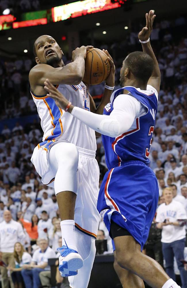 Oklahoma City Thunder forward Kevin Durant (35) drives past Los Angeles Clippers guard Chris Paul (3) in the fourth quarter of Game 5 of the Western Conference semifinal NBA basketball playoff series in Oklahoma City, Tuesday, May 13, 2014. Oklahoma City won 105-104. (AP Photo)
