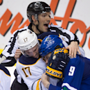 Linesman Bryan Pancich tries to break up a scuffle between Buffalo Sabres' Torrey Mitchell (17) and Vancouver Canucks' Zack Kassian (9) during the second period of an NHL hockey game Friday, Jan. 30, 2015, in Vancouver, British Columbia The Associated Pre