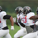 Atlanta Falcons players run during a training session at the Arsenal FC training ground in London Colney, England, Wednesday Oct. 22, 2014. The Falcons will play the Detroit Lions in an NFL football game at London's Wembley Stadium on Sunday, Oct. 26