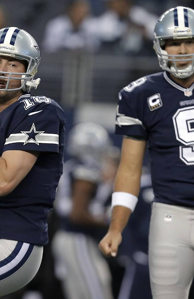 In this Nov. 28, 2013, photo, Dallas Cowboys quarterbacks Kyle Orton (18) and Tony Romo (9) warm up for an NFL football game against the Oakland Raiders in Arlington, Texas. Orton will make his first start at quarterback in his two seasons with the Cowboys on Sunday night, Dec. 29, unless Romo can recover from a herniated disc. Dallas will be playing a winner-take-all game at home against the Philadelphia Eagles for the NFC East title and a playoff berth