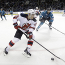 New Jersey Devils' Mike Cammalleri (23) controls the puck in front of San Jose Sharks' Marc-Edouard Vlasic (44) during the second period of an NHL hockey game Monday, Jan. 19, 2015, in San Jose, Calif The Associated Press