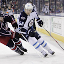 Winnipeg Jets' Mark Scheifele, right, controls the puck as Columbus Blue Jackets' James Wisniewski defends during the first period of an NHL hockey game Tuesday, Nov. 25, 2014, in Columbus, Ohio The Associated Press