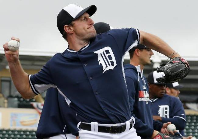 Detroit Tigers pitcher Max Scherzer warms up before an exhibition spring training baseball game against the Atlanta Braves in Lakeland, Fla.,  Thursday, Feb. 27, 2014