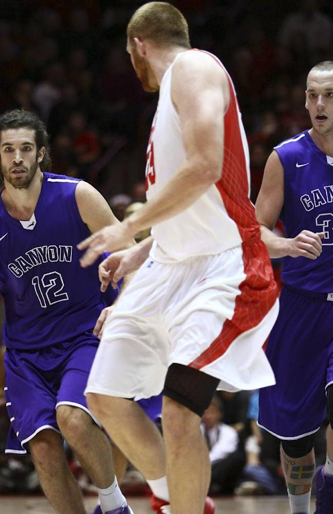 Grand Canyon forward Daniel Alexander (12) drives to the basket during the first half of an NCAA college basketball game against New Mexico in Albuquerque, N.M., Monday Dec. 23, 2013