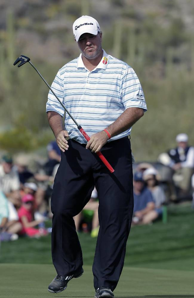 Boo Weekley misses a birdie putt on the 16th hole in his match against Rory McIlroy, of Northern Ireland, during the first round of the Match Play Championship golf tournament on Wednesday, Feb. 19, 2014, in Marana, Ariz