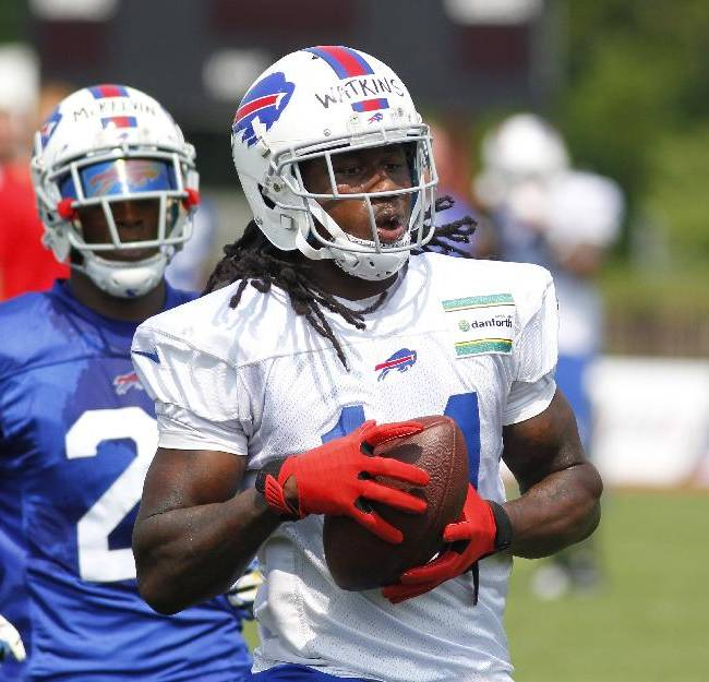 Buffalo Bills wide receiver Sammy Watkins (14) makes a reception against corner back Leodis McKelvin (21) during their NFL football training camp in Pittsford, N.Y., Monday, July 21, 2014