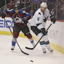 San Jose Sharks defenseman Jason Demers, right, pursues the puck with Colorado Avalanche center Maxime Talbot during the first period of an NHL hockey game in Denver on Tuesday, Oct. 28, 2014 The Associated Press