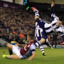 Aston Villa s Ciaran Clark (left) and West Bromwich Albion s Morgan Amalfitano battle for the bal during the English Premier League match at The Hawthorns, West Bromwich,Monday Nov.25, 2013