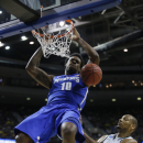 Memphis forward Tarik Black dunks against Michigan State forward Adreian Payne (5) in the second half of a third-round game of the NCAA college basketball tournament Saturday, March 23, 2013, in Auburn Hills, Mich. Michigan State defeated Memphis 70-48. (AP Photo/Duane Burleson)