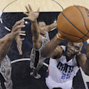Charlotte Bobcats' Al Jefferson (25) shoots over San Antonio Spurs' Tim Duncan, left, and Boris Diaw, center, during the first half of an NBA basketball game, Friday, Feb. 28, 2014, in San Antonio The Associated Press