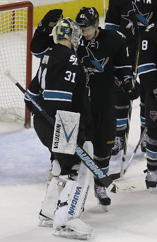 San Jose Sharks goalie Antti Niemi (31), from Finland, celebrates with defenseman Justin Braun (61) at the end of the third period of an NHL hockey game against the Los Angeles Kings in San Jose, Calif., Thursday, April 3, 2014. The Sharks won 2-1