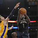 New Orleans Pelicans guard Tyreke Evans, right, puts up a shot as Los Angeles Lakers center Pau Gasol, of Spain, defends during the first half of an NBA basketball game, Tuesday, Nov. 12, 2013, in Los Angeles The Associated Press