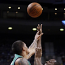 Detroit Pistons guard Rodney Stuckey, right, is fouled by Boston Celtics guard Chris Babb (52) while taking a shot during the first half of an NBA basketball game Saturday, April 5, 2014, in Auburn Hills, Mich. Stuckey led the Pistons with 26 points in a