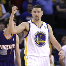 Warriors win 4th straight, hold off Suns 113-107 The Associated Press