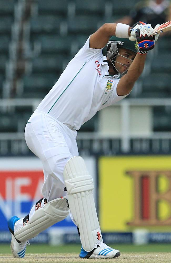 South Africa's batsman Jean-Paul Duminy is bowled for 5 runs during the fourth and final day of their cricket test match against India at Wanderers stadium in Johannesburg, South Africa, Sunday, Dec. 22, 2013