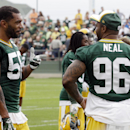 Green Bay Packers' Julius Peppers talks to Mike Neal during NFL football training camp on Saturday, July 26, 2014, in Green Bay, Wis The Associated Press