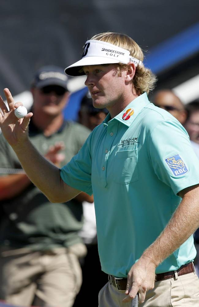 Brandt Snedeker acknowledges the gallery's applause after making a birdie on the 13th green during the first round of the BMW Championship golf tournament at Conway Farms Golf Club in Lake Forest. Ill., Thursday, Sept. 12, 2013