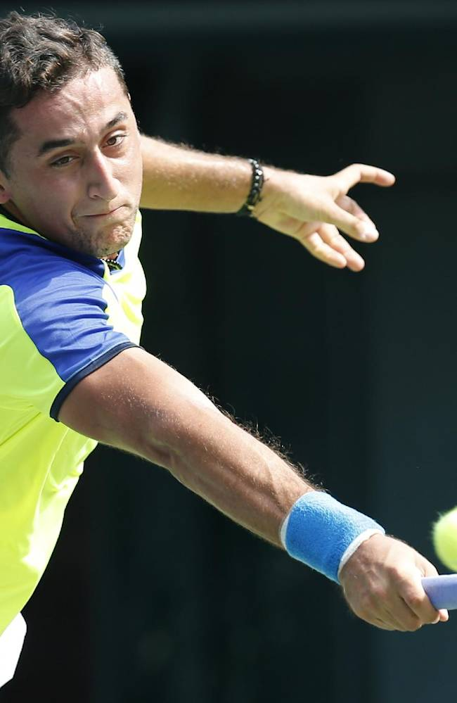 Nicolas Almagro of Spain returns a shot to Benjamin Becker of Germany during their first round match of the Japan Open tennis championships in Tokyo, Monday, Sept. 30, 2013
