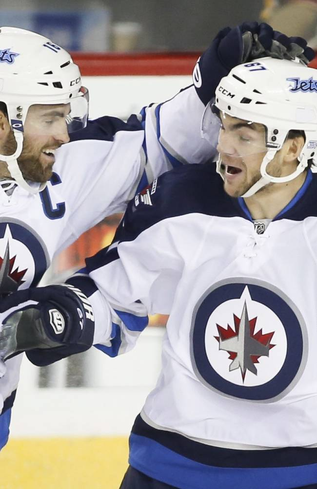 Jets surge past reeling Flames 5-2