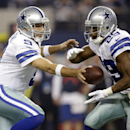 Dallas Cowboys quarterback Tony Romo (9) hands off the ball to running back DeMarco Murray (29) during the first half of an NFL football game against the Indianapolis Colts, Sunday, Dec. 21, 2014, in Arlington, Texas. (AP Photo/Tim Sharp)