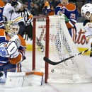 Buffalo Sabres Brian Gionta (12) watches the puck go in the net past Edmonton Oilers goalie Ben Scrivens (30) during the first period of an NHL hockey game Thursday, Jan. 29, 2015, in Edmonton, Alberta The Associated Press