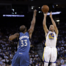 Golden State Warriors' Stephen Curry (30) shoots over Minnesota Timberwolves' Dante Cunningham (33) during the second half of an NBA basketball game on Monday, April 14, 2014, in Oakland, Calif. Golden State won 130-120 The Associated Press